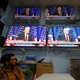 An Afghan man watches TV coverage of President Trump's address.