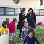 Adults and children explore an urban play-garden.