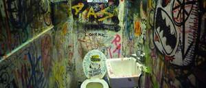 photo: a very filthy punk club bathroom