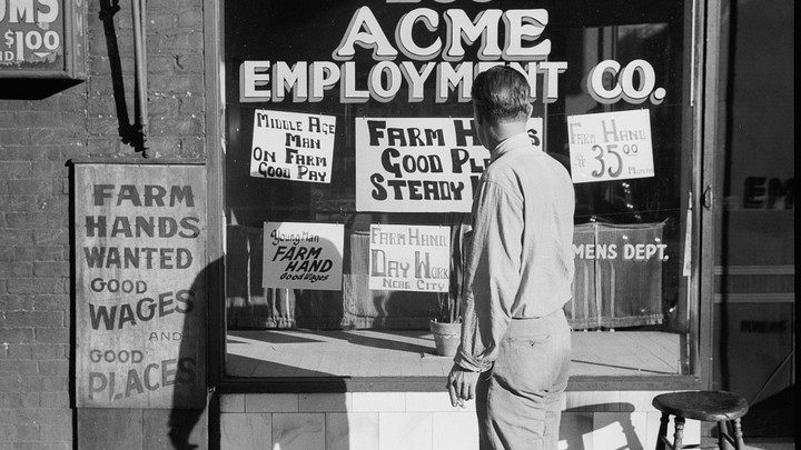 A man stands in front of employment signs
