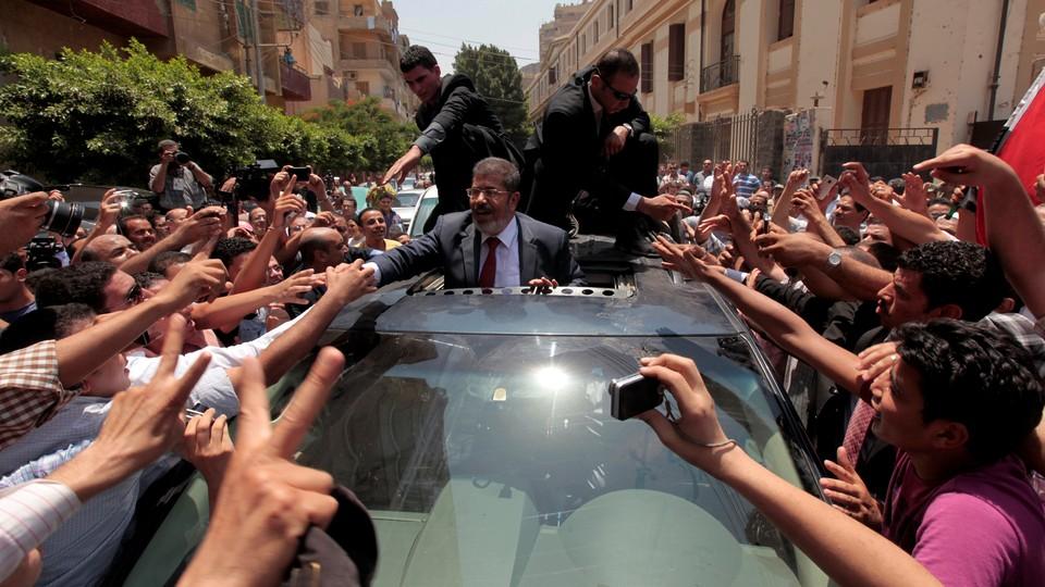 Mohamed Morsi greets supporters during Egypt's June 2012 presidential election.