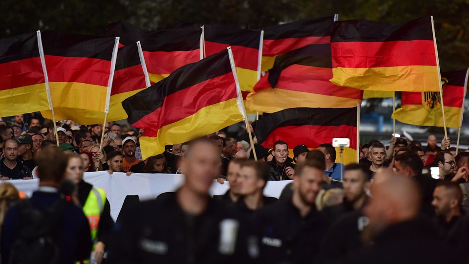 Right-wing activists hold German flags at a demonstration in Chemnitz in September.