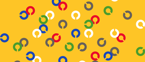 Multiple letter c's in white, grey, blue, green, and red over a yellow background