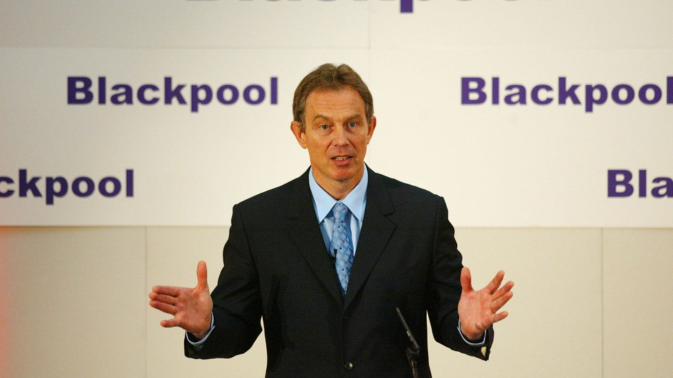 Tony Blair speaks at a podium at the Imperial Hotel in Blackpool.