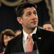 House Speaker Paul Ryan holds a sample postcard-size tax form.