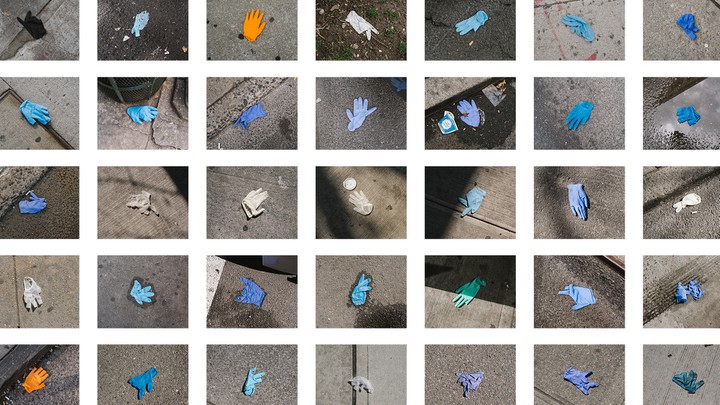Grid of discarded gloves on the ground