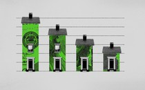 An illustration of houses made up of U.S. money
