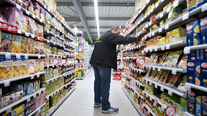 An employee works in a Carrefour grocery store in Riaille, France