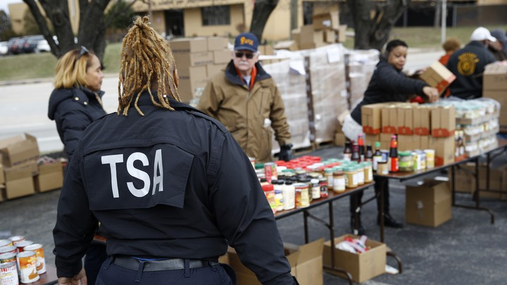 Princess Young, a Transportation Security Administration employee, visits a food pantry for furloughed government workers last week in Baltimore.
