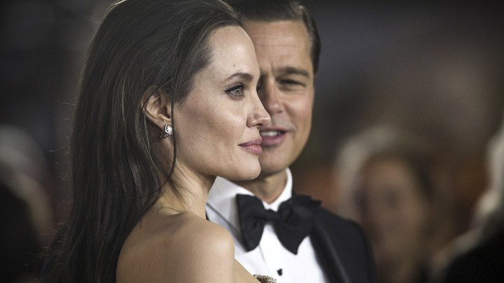 Angelina Jolie and Brad Pitt at an event