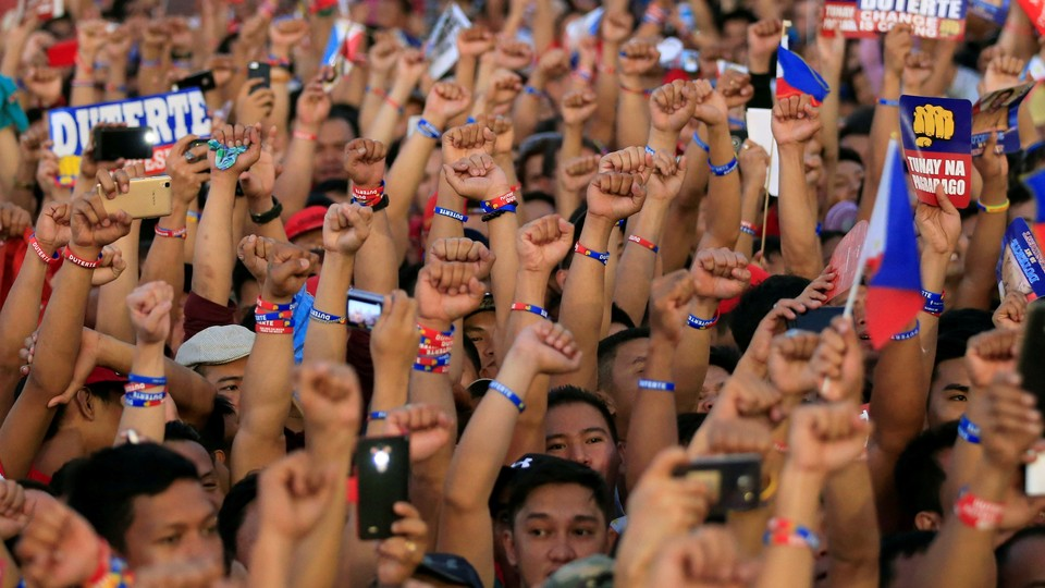 Supporters of Philippine presidential candidate and Davao city mayor Rodrigo Duterte in May 2016