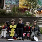 Photo: Children dressed in costumes eat pizza at the Flint family's annual Halloween block party in Silver Spring, MD