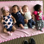 Babies rest at a hospital in Bay Minette, Alabama, as their mothers participate in a group post-pregnancy session.