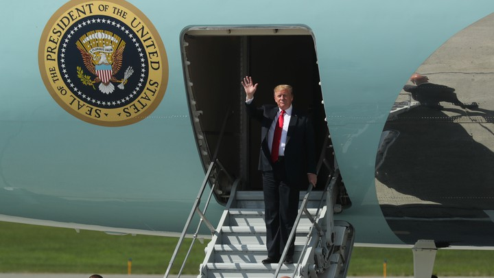 Trump waves from Air Force One.