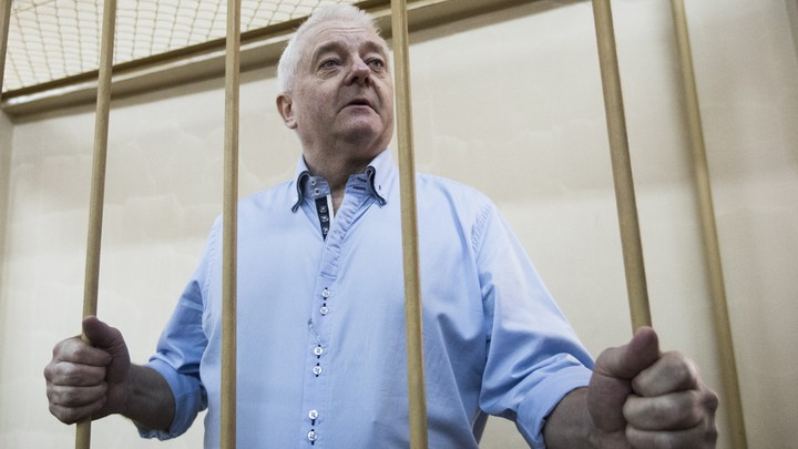 Frode Berg holding jail cell bars