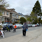 "photo: A family walks down West 19th Street in Oakland, part of the city's ""slow streets"" network."
