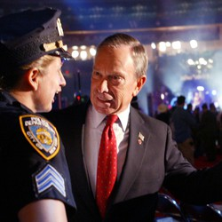 Michael Bloomberg speaking with New York City police sargeant Diane Harwisher at the Republican National Convention in 2004.