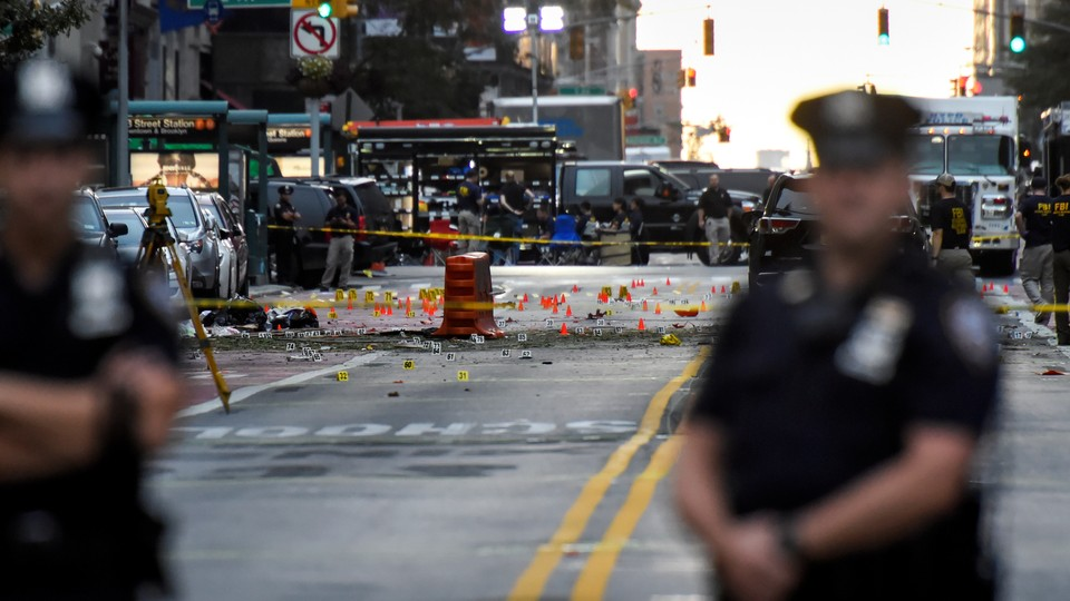 New York police officers stand near the site of an explosion in Manhattan's Chelsea neighborhood.