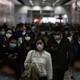 People in Hong Kong wearing face masks.