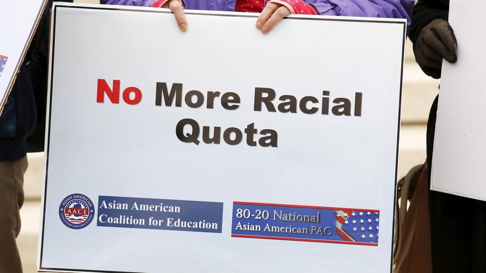 "A sign says ""No More Racial Quota"""