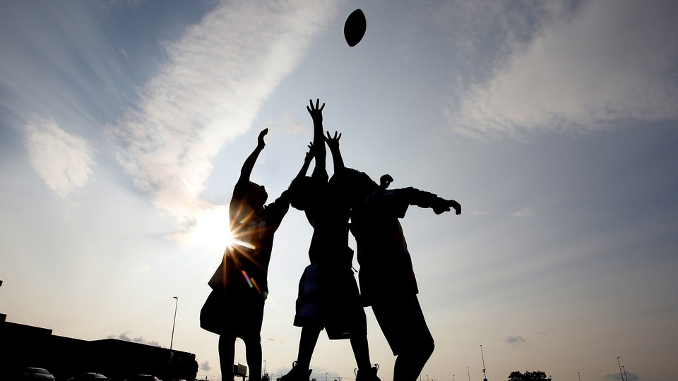 Children play football.