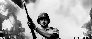 A National Guardsman stands at a Detroit intersection during the summer riots of 1967.