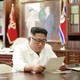 North Korean leader Kim Jong Un reads a letter from American President Donald Trump.