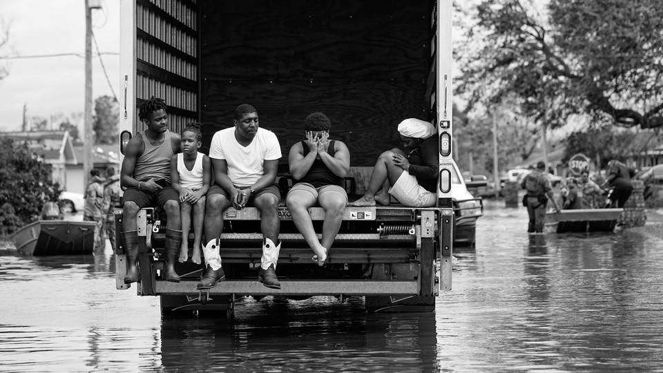 A family during Hurricane Ida.