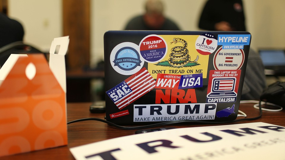 A computer covered in pro-Trump stickers sits on a table at a campaign office in New Hampshire