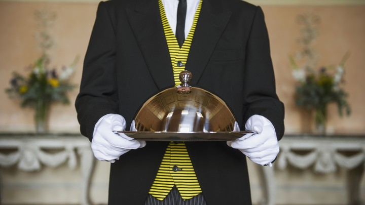 Butler holding a serving tray