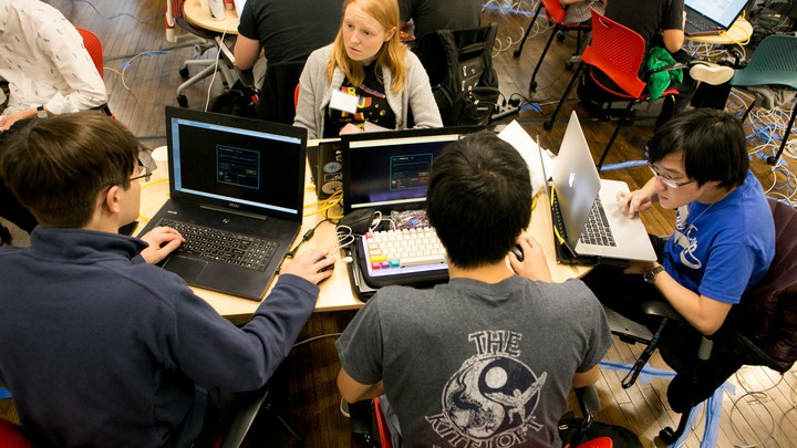 "Members of ""Hoya Haxa,"" a team of Georgetown University students, participate in a hacking competition."