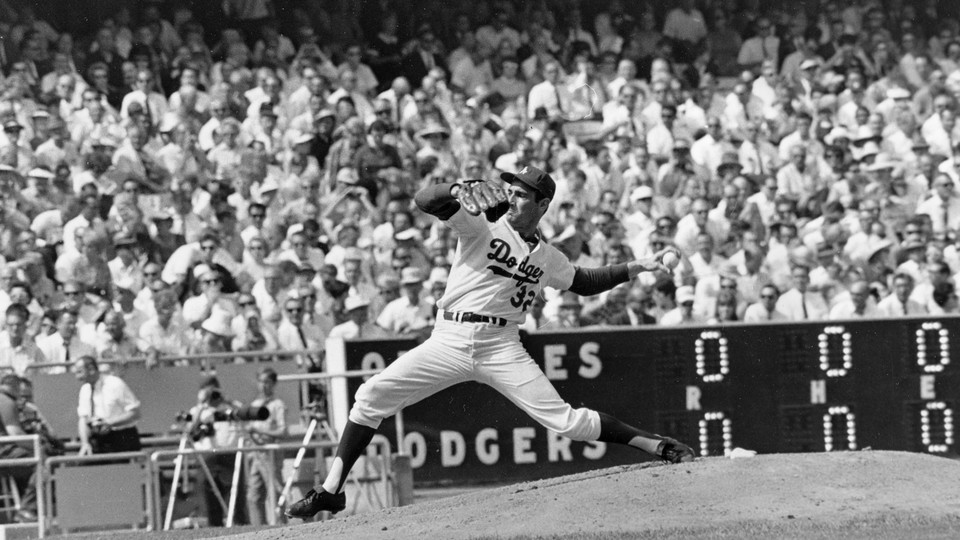Sandy Koufax throws a pitch against the Baltimore Orioles in a World Series game in Los Angeles on October 6, 1966.