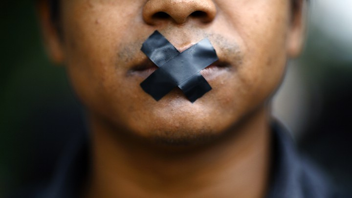 A man with tape over his mouth.
