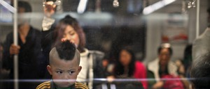 A kid with a Mohawk hairdo travels on the subway line number 2 in Shanghai