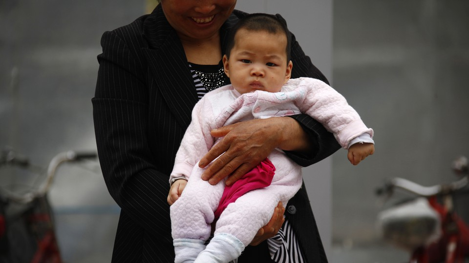 A woman holds a baby.