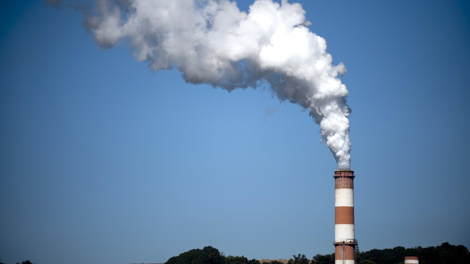 A plume of exhaust rises from a smokestack