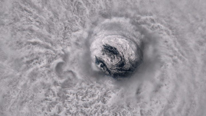 The massive circular eye of Hurricane Jose is seen from space at super high resolution. Convection is visible in the clouds that surround the well-defined eyewall, and the whitecaps of waves can be glimpsed through the center of the eye.