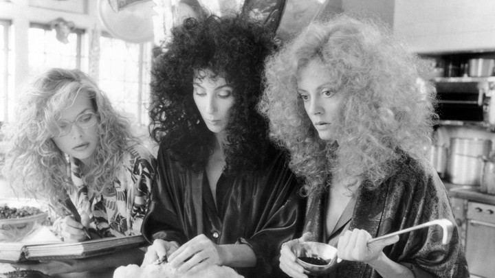 Michelle Pfeiffer, Cher, and Susan Sarandon in George Miller's <i>The Witches of Eastwick</i>, which is alternately uproarious, sexy, and deeply gross