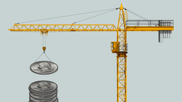 An illustration of a construction crane lifting coins.