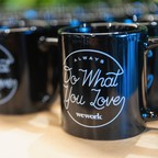 "WeWork-branded coffee mugs that say ""Always do what you love"""