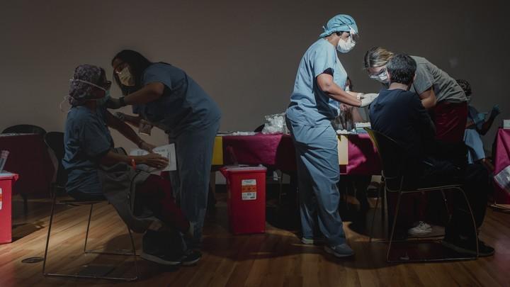 Staff at Temple University Hospital receive the coronavirus vaccine in Philadelphia, Dec. 16, 2020.