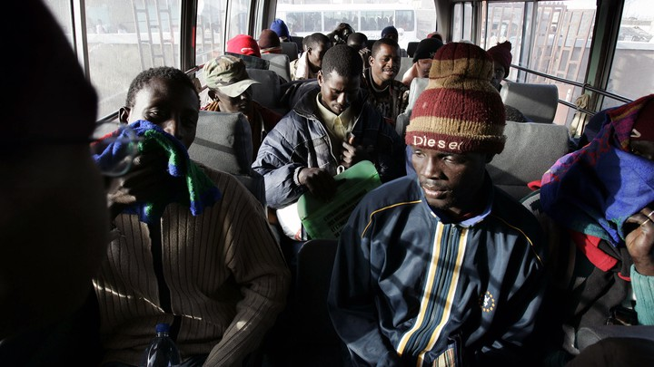 Would-be immigrants sit in a police bus in Nouadhibou, Mauritania, after being detained while trying to leave for Europe.