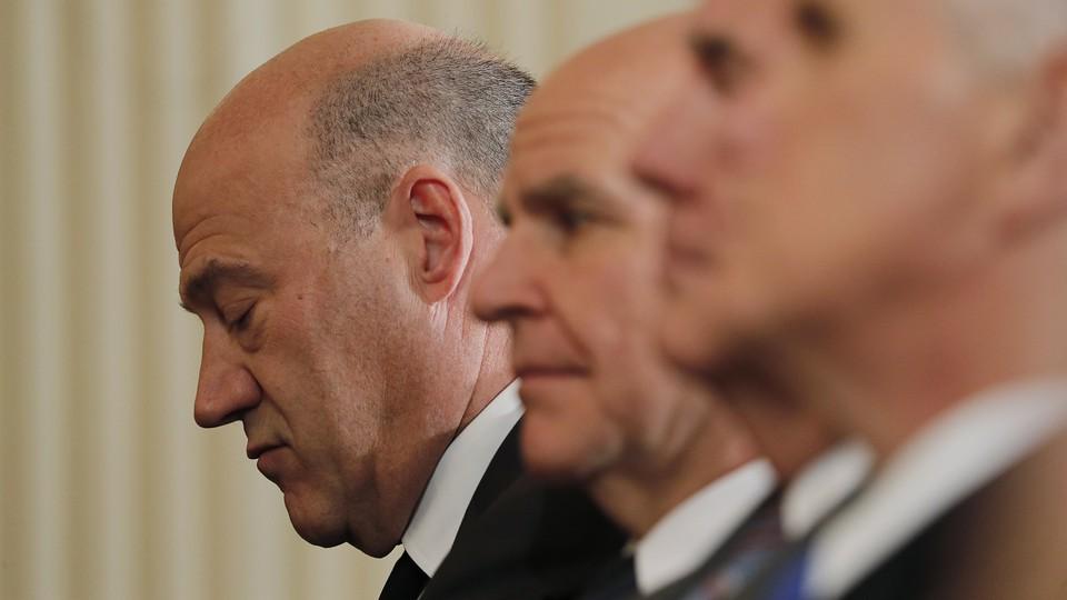 Gary Cohn looks downcast next to senior White House officials