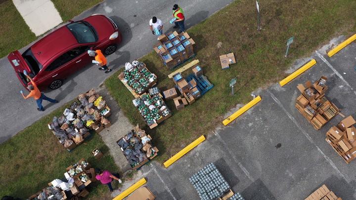 Aerial view of volunteers distributing food.