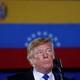 Donald Trump speaks in front of a Venezuelan flag.