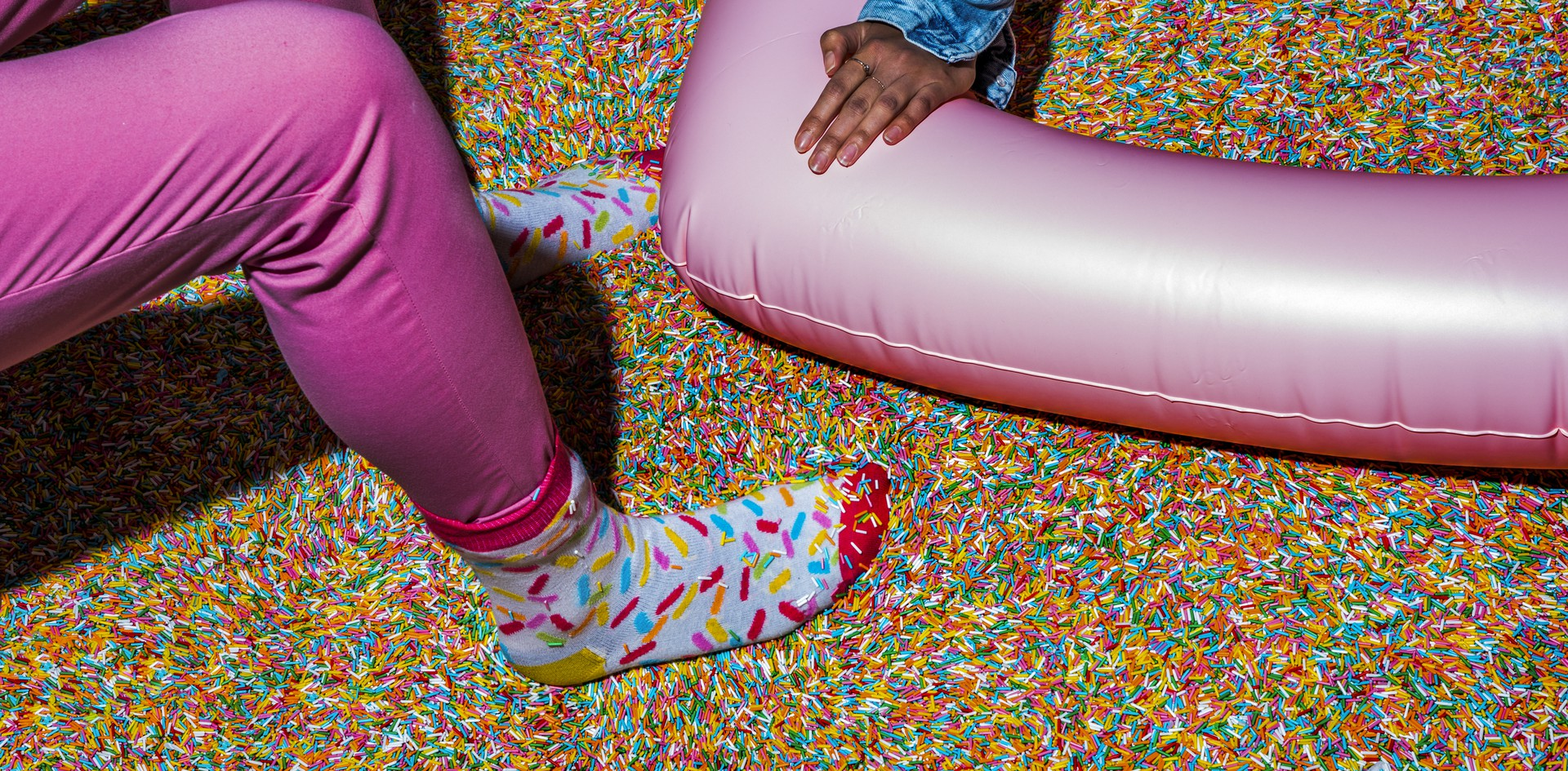 Museum of Ice Cream employees in a sprinkle pool