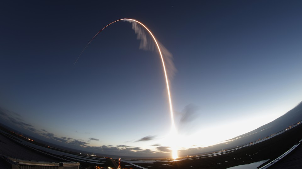 A long-exposure view of the Atlas V rocket, with the Boeing Starliner capsule on top, launching into space this morning