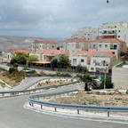 The Israeli settlement of Ma'ale Adumim, about four miles east of Jerusalem, features well-kept villas with solar panels on their roofs.