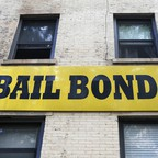 A bail bonds sign hangs on the side of a bail bonds business near Brooklyn's courthouse complex and jail.