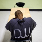 A young teenager sits in a classroom at Atlanta's Metro Regional Youth Detention Center.